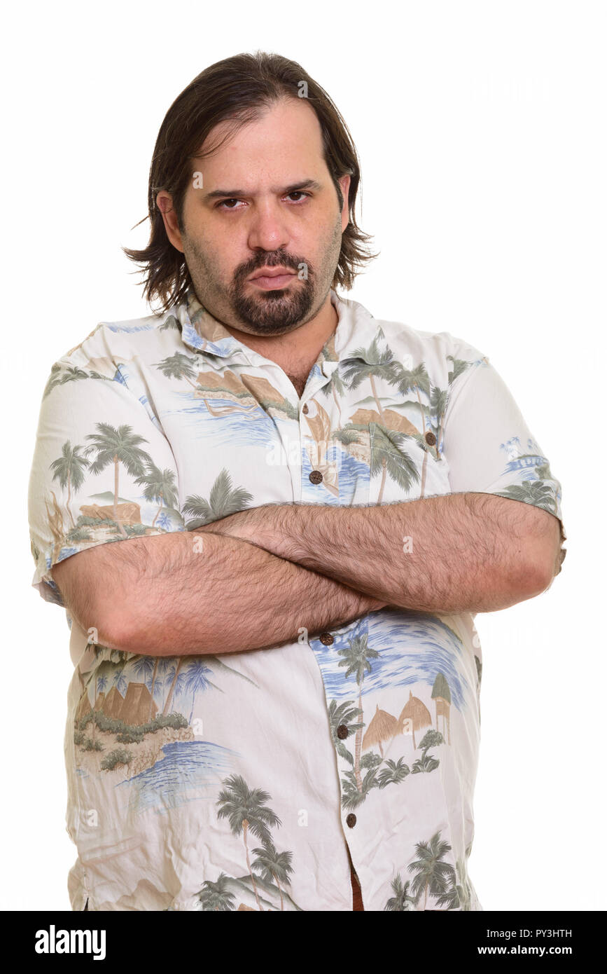 Fat Caucasian man looking angry with arms crossed - Stock Image