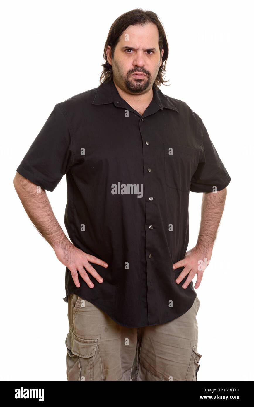 Angry fat Caucasian man looking at camera - Stock Image
