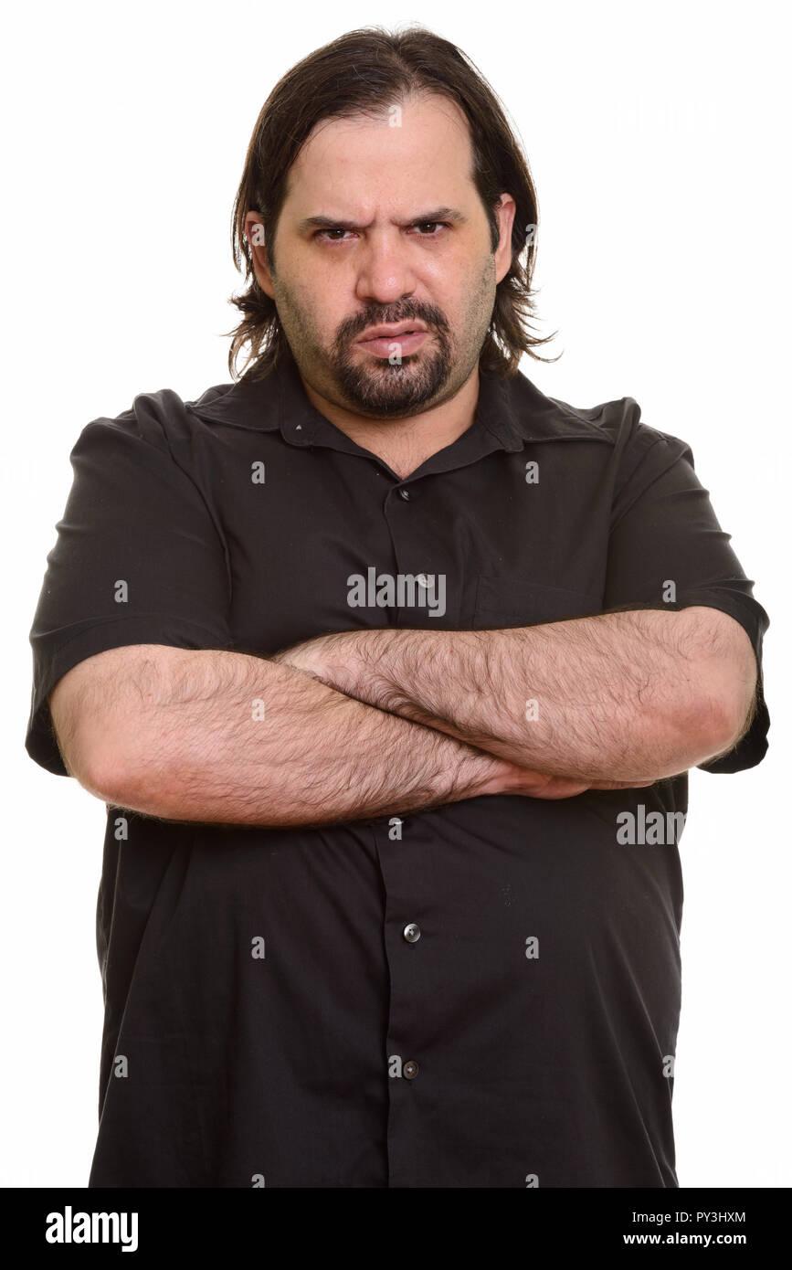 Fat angry Caucasian man looking at camera - Stock Image