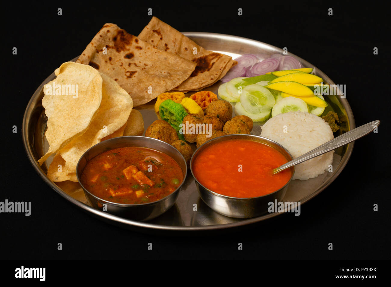 Authentic Maharashtrian Amras  and Puranpoli lunch, India. - Stock Image