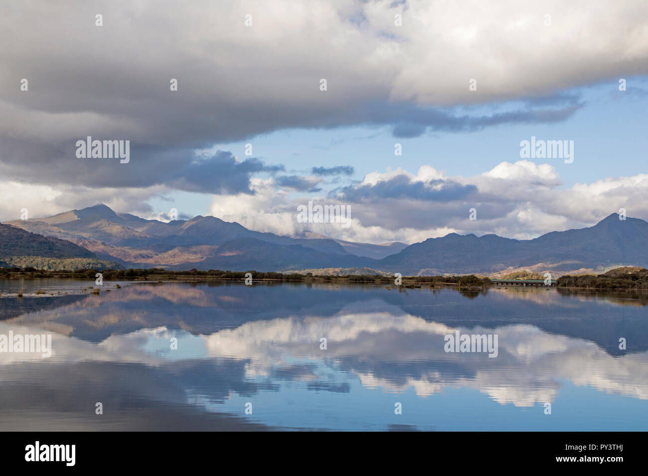 The Glaslyn Estuary from the Cob at Porthmadog with the Snowdon Horseshoe reflected in the distance,Snowdonia National Park, North Wales, UK Stock Photo