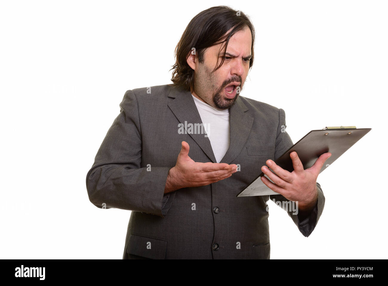 Fat Caucasian businessman looking angry while pointing and readi - Stock Image