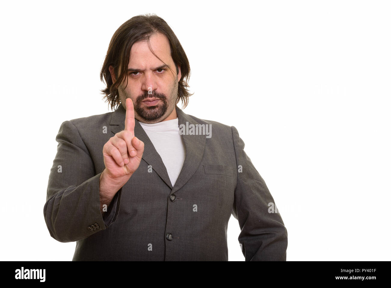 Fat Caucasian businessman looking angry with finger up - Stock Image