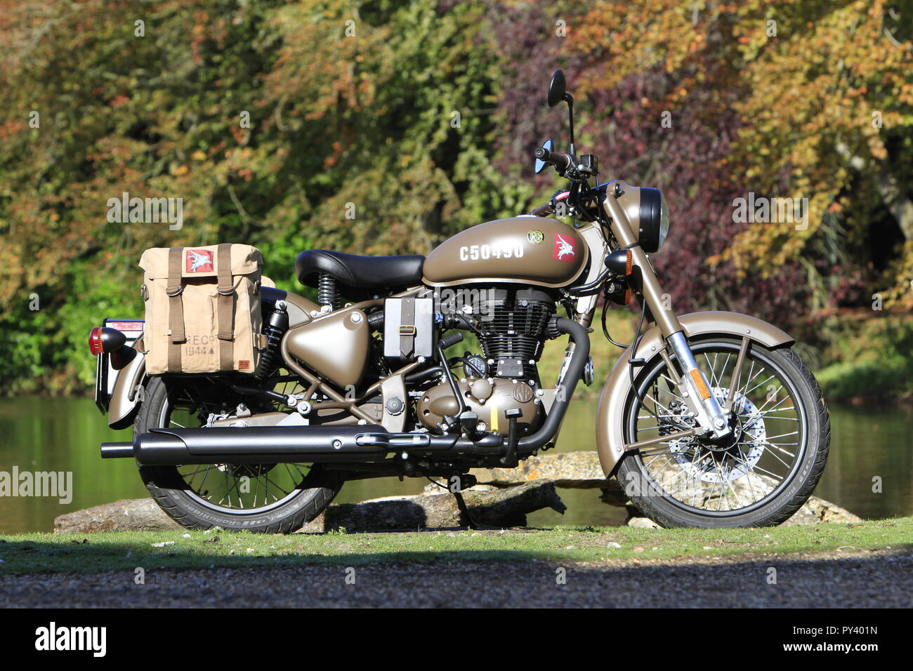 Royal Enfield Pegasus autumn trees leaves golden army Flying flea D Day landings Camouflage motorcycle world war two - Stock Image