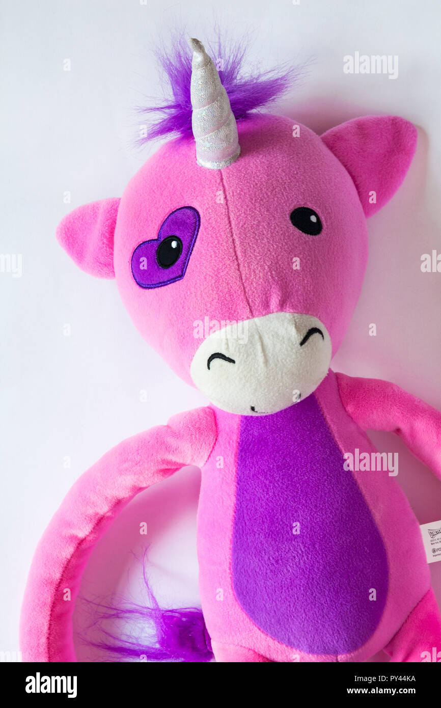 Stretchkins Unicorn Soft Toy Set On White Background Stock Photo