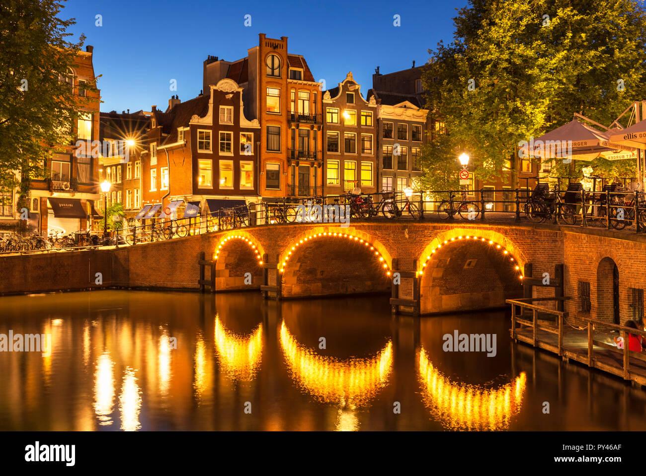 Amsterdam Illuminated canal bridge over the Singel Torensluis Canal Amsterdam canal amsterdam bridge Holland The Netherlands EU Europe Stock Photo