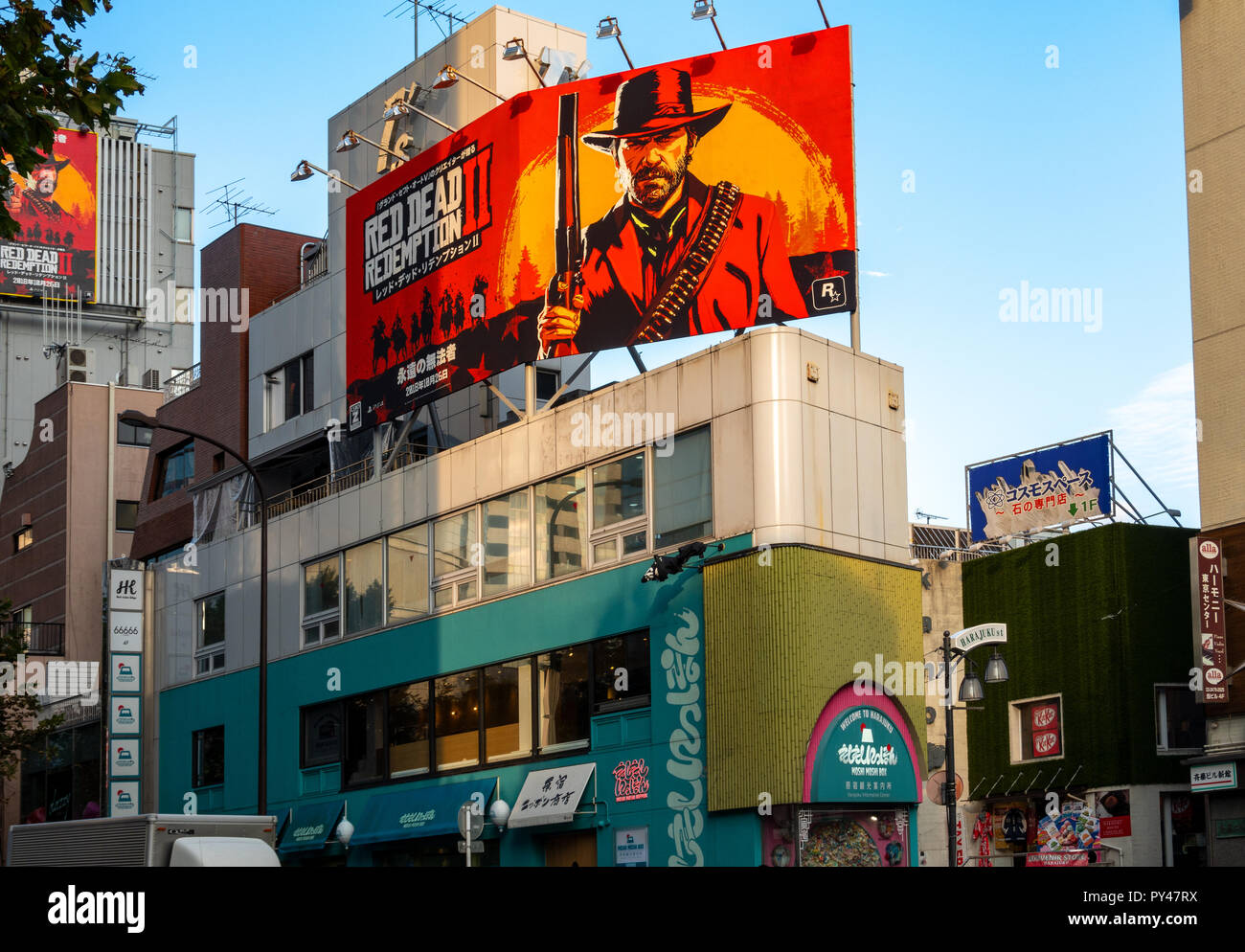 Red Dead Redemption II Game new release billboard in Tokyo Harajuku. Billboards corner Harajuku St and Meji St on Moshi Moshi Box building. Oct 2018 - Stock Image