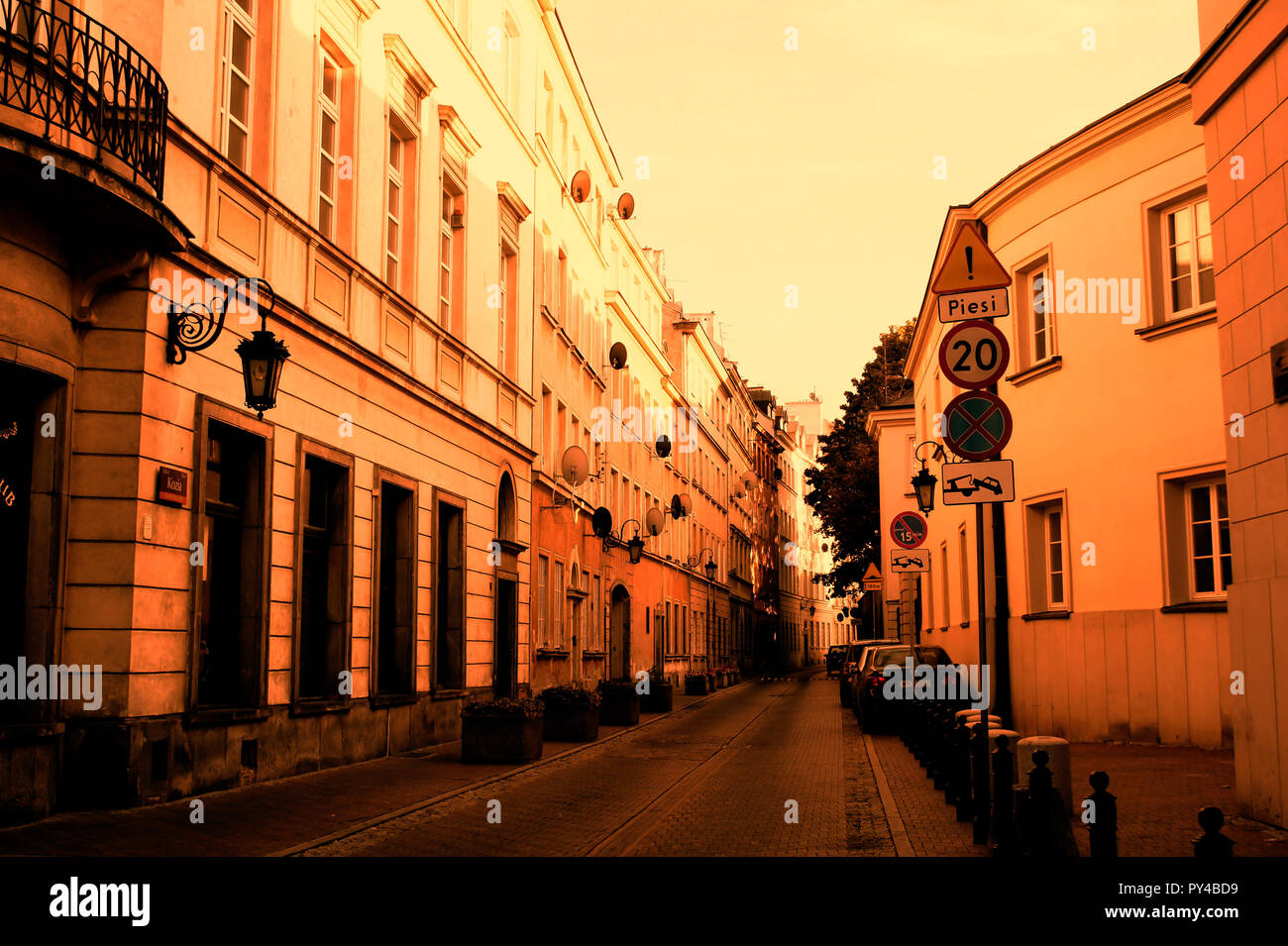 Part of a street in the older part of Warsaw in low key warm tones - Stock Image