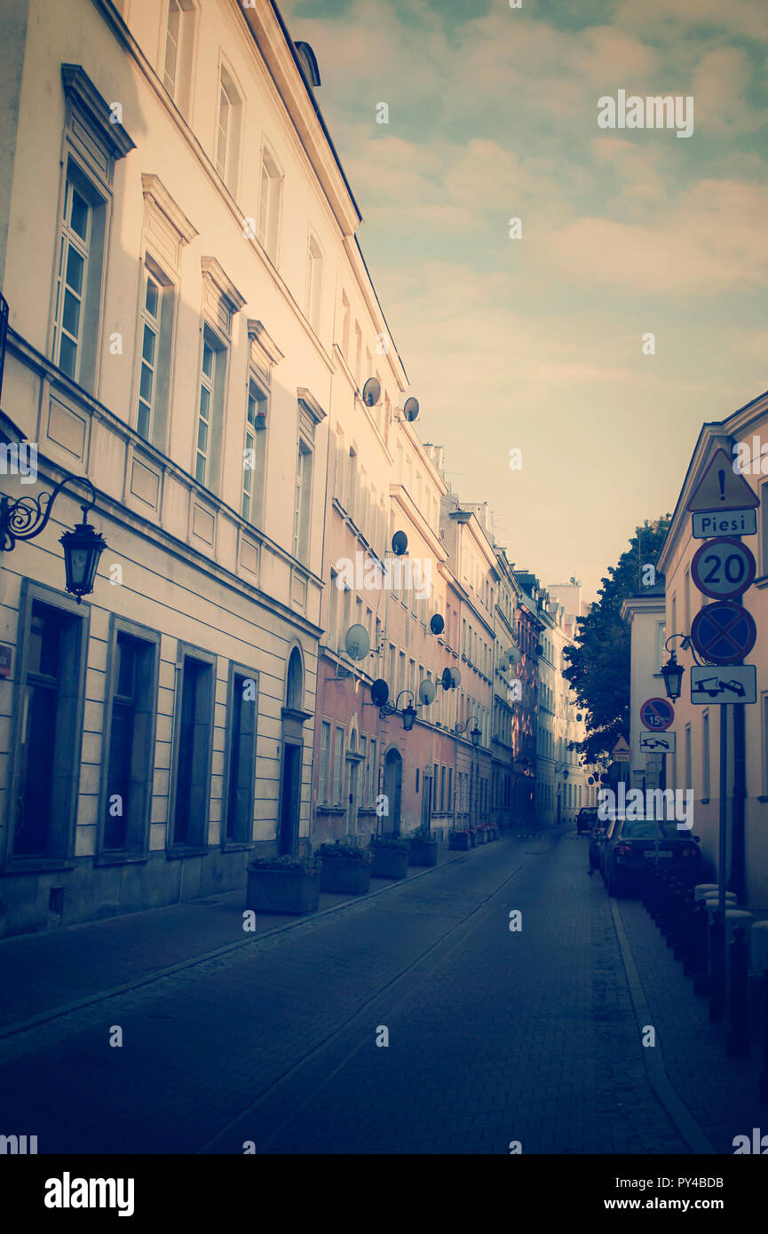 Part of a street in the older part of Warsaw in low key pastel tones - Stock Image