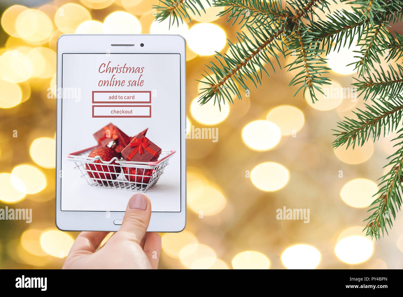 Christmas online sale. Tablet for buying gifts online on a Christmas ...