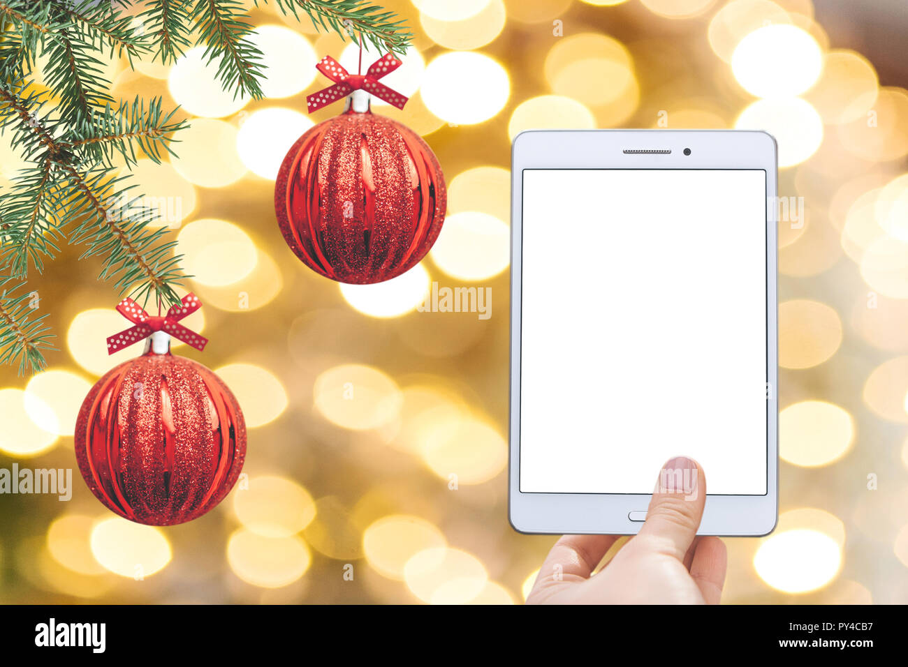 christmas online sale tablet for buying gifts online tablet with an empty white screen on the background of christmas decorations