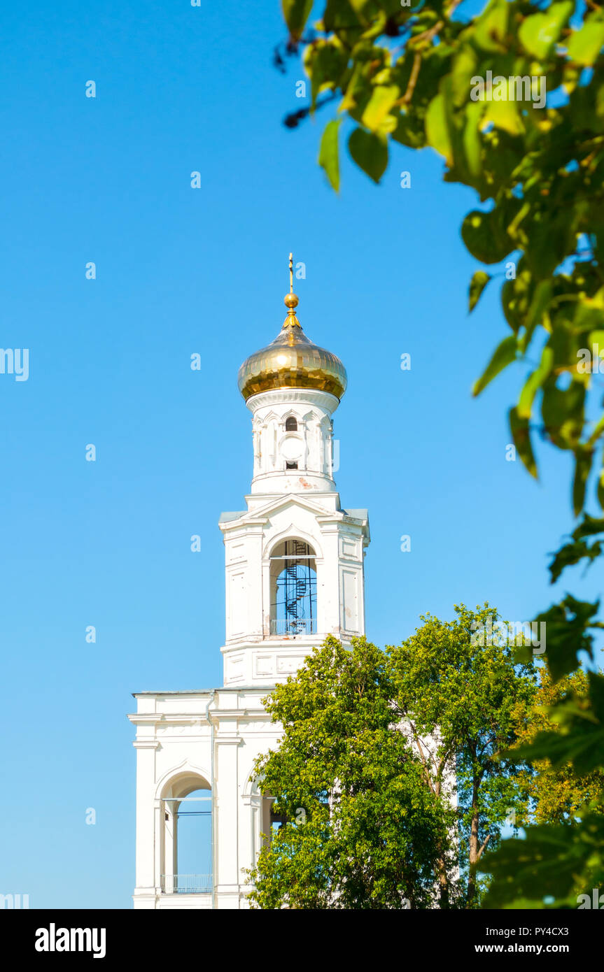 Veliky Novgorod, Russia. Belfry on the territory of Russian orthodox Yuriev Monastery in sunny day - Stock Image