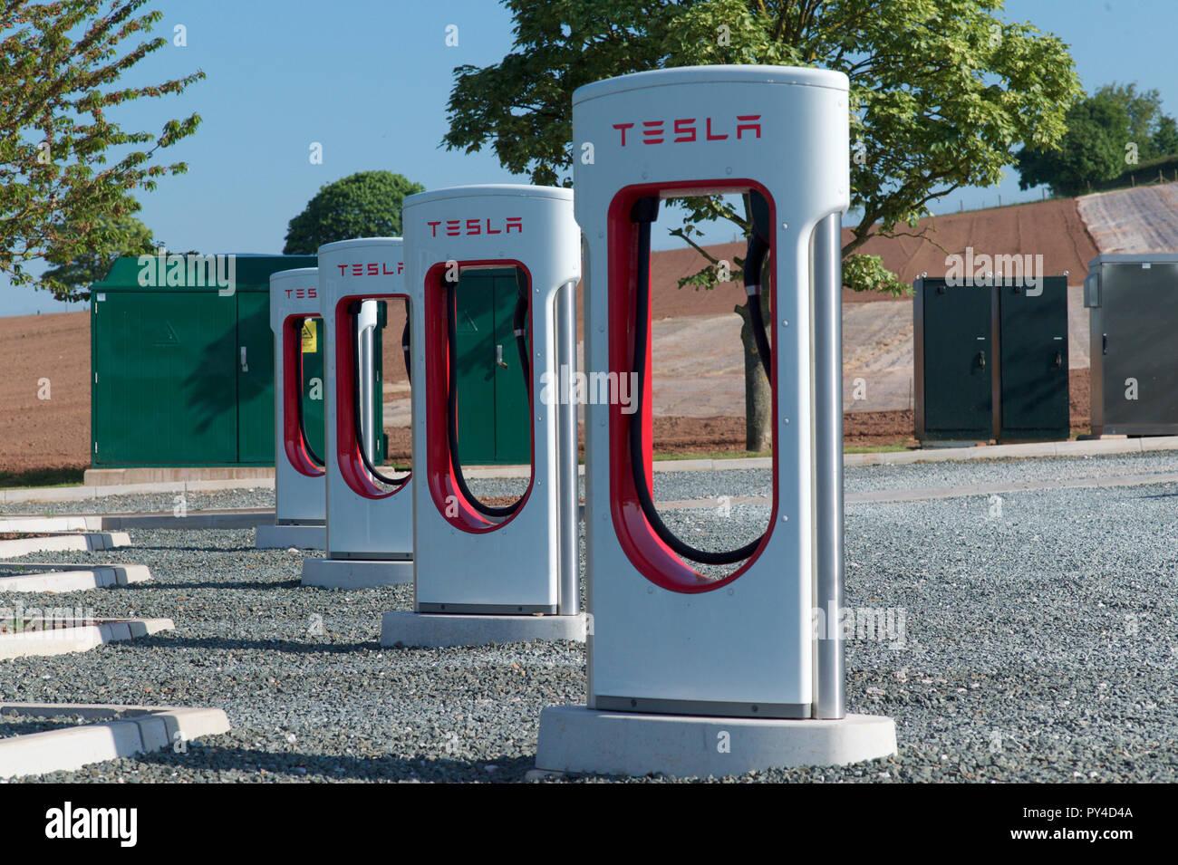 Tesla. Electric charging point, UK - Stock Image