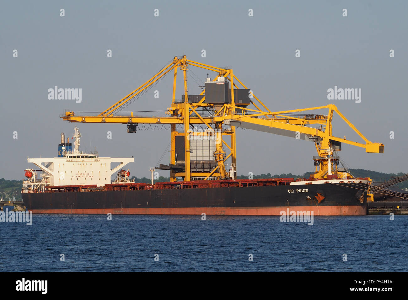 Capesizebulker CIC Pride discharging coal at Aabenraa powerplantStock Photo