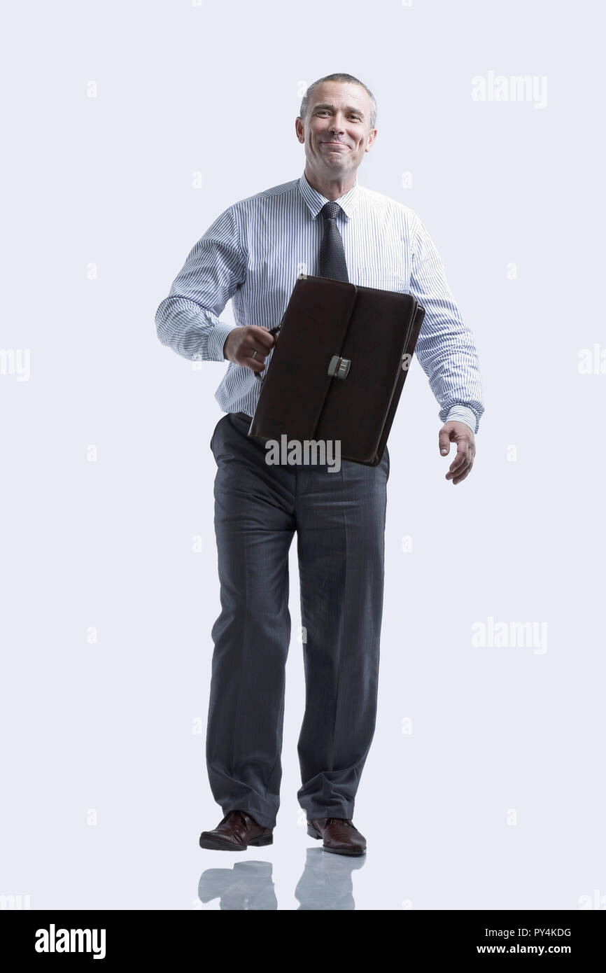 modern business man with a briefcase going forward - Stock Image