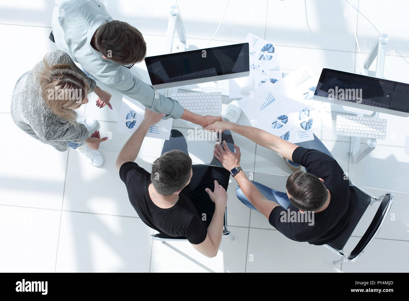 young businessmen make a deal - Stock Image