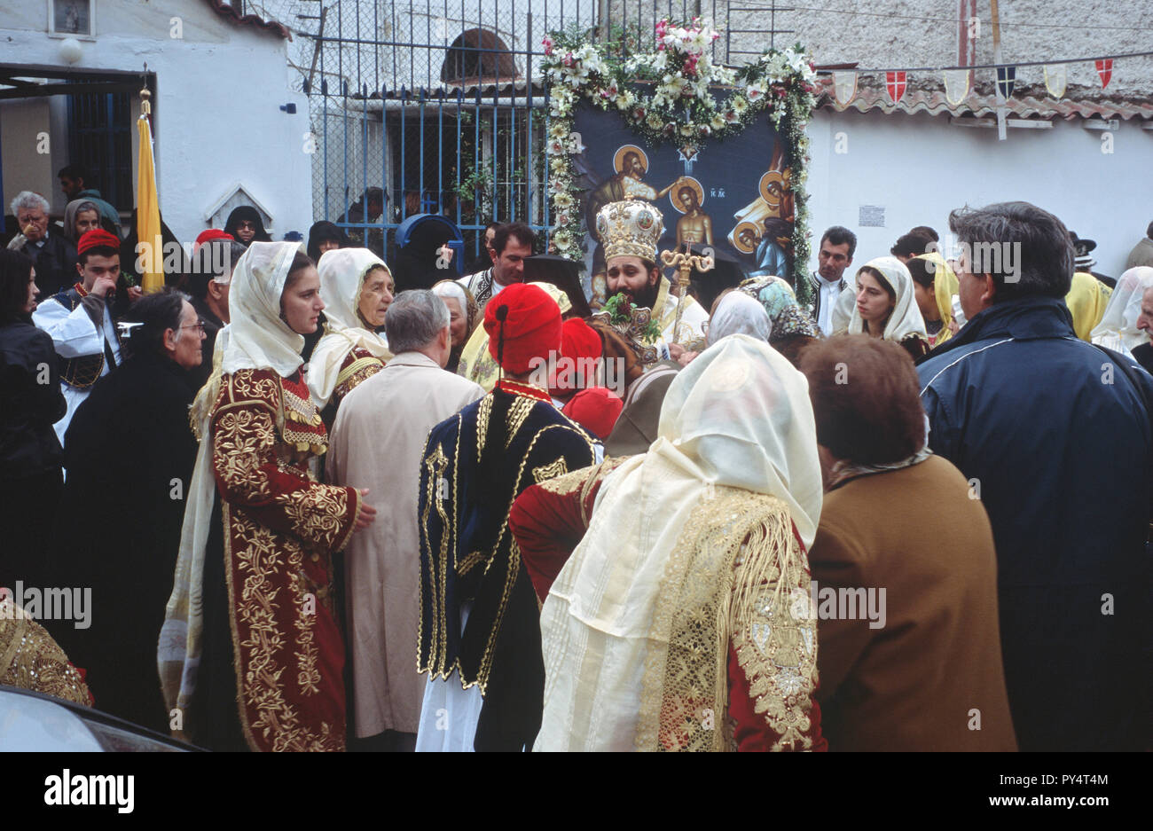 Bishop blesses the faithful during Epiphany at Piraeus, Greece. The Bishop belongs to the 'Old Church' that still uses the Julian calendar. - Stock Image