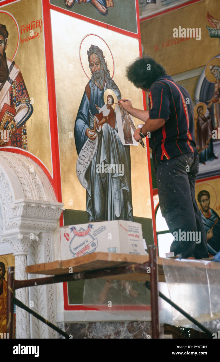 Icon painter Ilias Georgatos at work in a new church at St Gerasimos Monastery, Kefallonia, Greece. It will take him 10 years to finished the work. - Stock Image