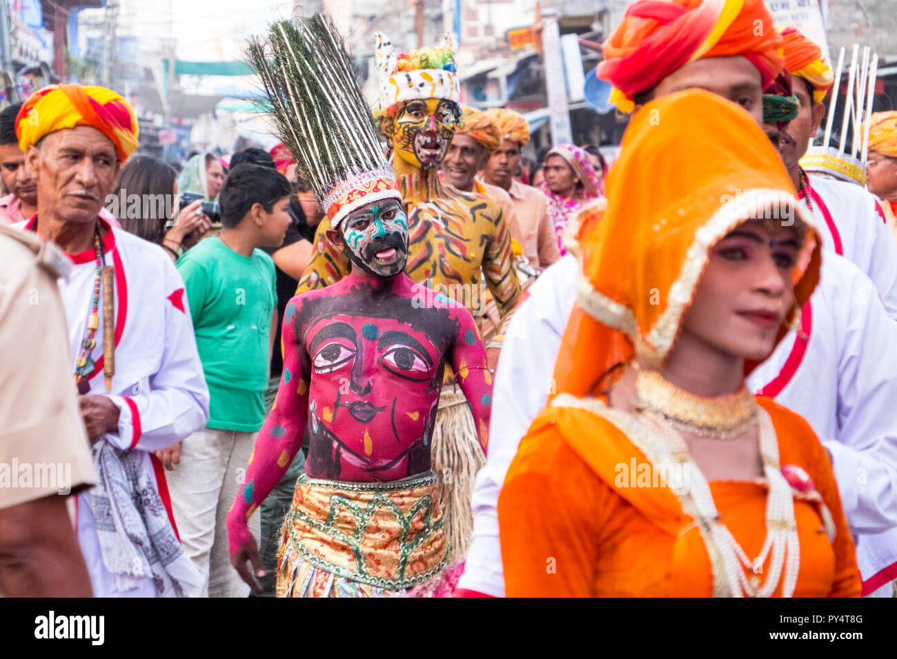 Colourful body-painted characters in a parade in Rajasthan India - Stock Image
