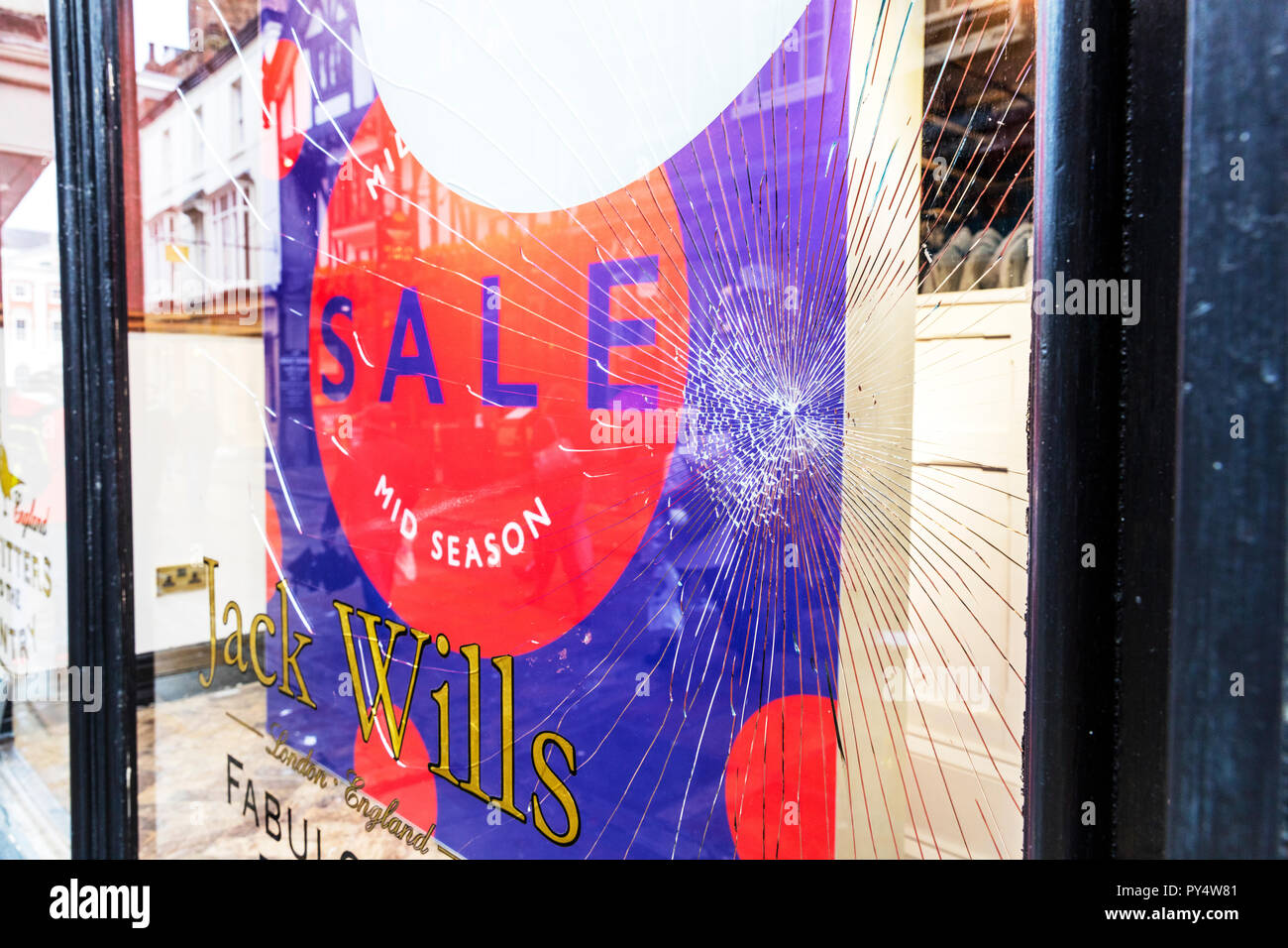 Broken window, smashed window, vandalised window vandalism, shattered glass, smashed glass, laminated glass, glass broken, shattered window, broken - Stock Image