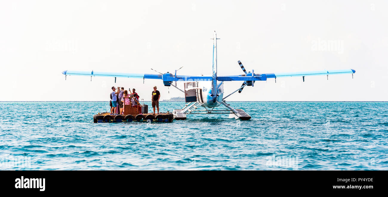 HAWAII, USA - FEBRUARY 18, 2018: Seaplane and tourists on the water. Copy space for text - Stock Image