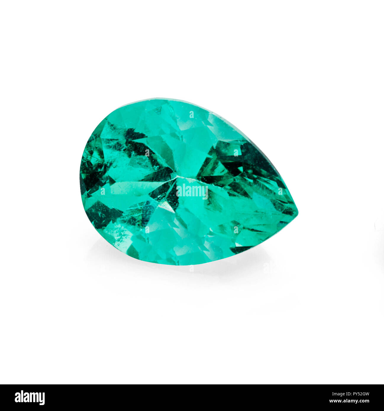 1.23 carat, pear shape cut green emerald gemstone on a white background - Stock Image
