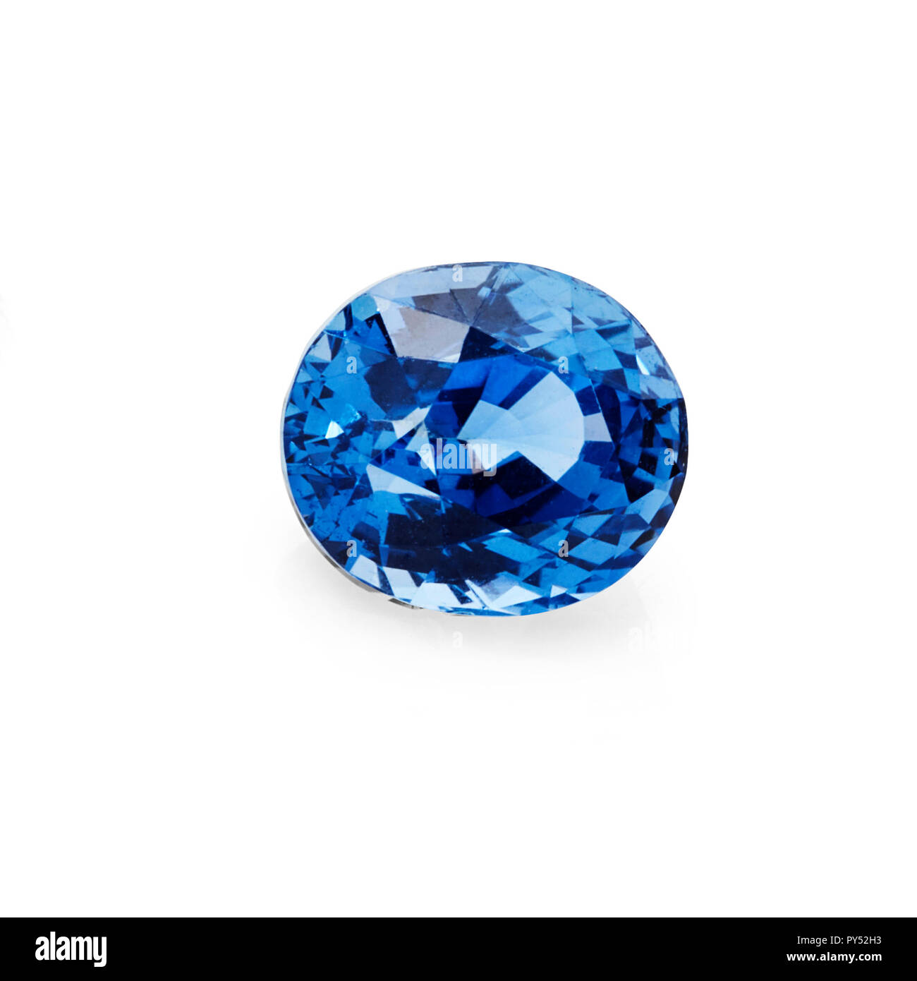 1.61ct blue sapphire gemstone on a white background - Stock Image