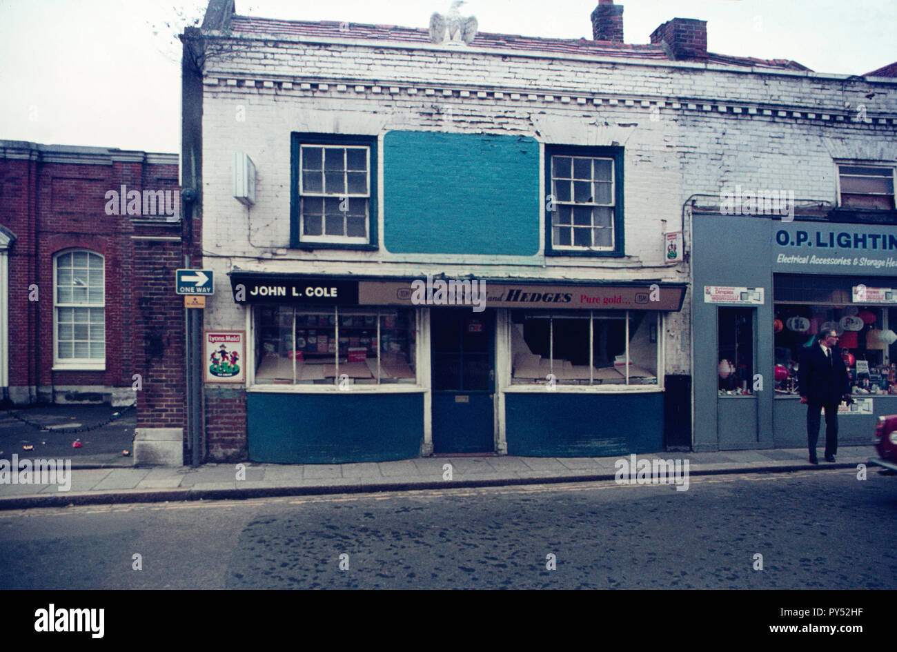 Traditional sweet shop in Cosham High Street, 1975 on a Sunday as the covered window displays show Stock Photo
