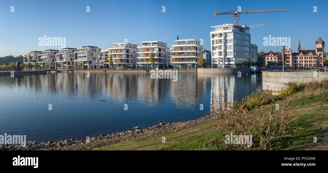 Dortmund, Germany, October 20., 2018: Panorama of the Neubaten at the Phönix Lake with the construction site for the office Stock Photo
