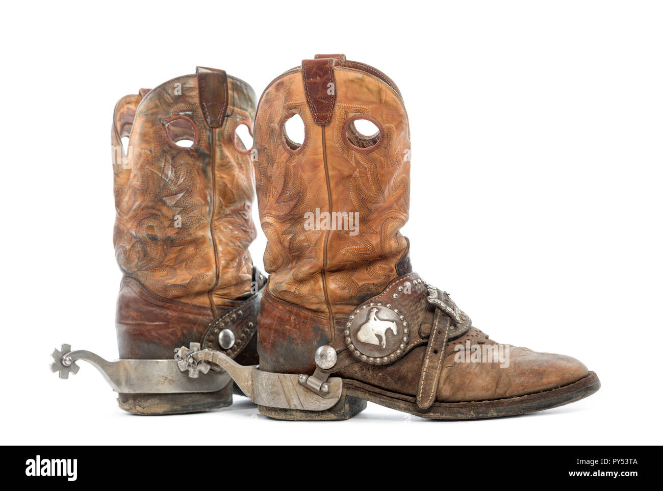 57fa206e9cc Side view of a pair of Cowboy boots with spurs, isolated on white ...