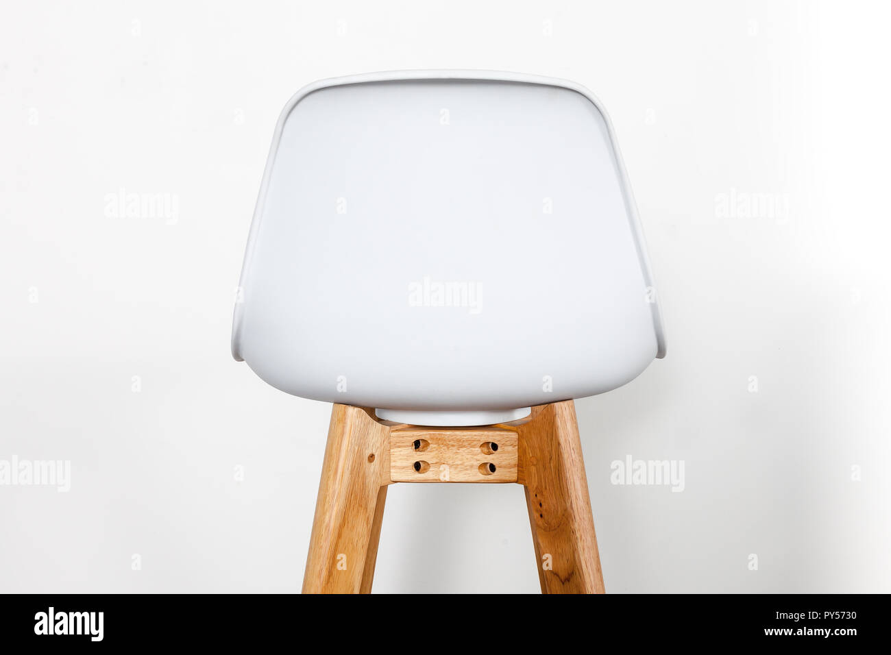back of a white footstool - Stock Image