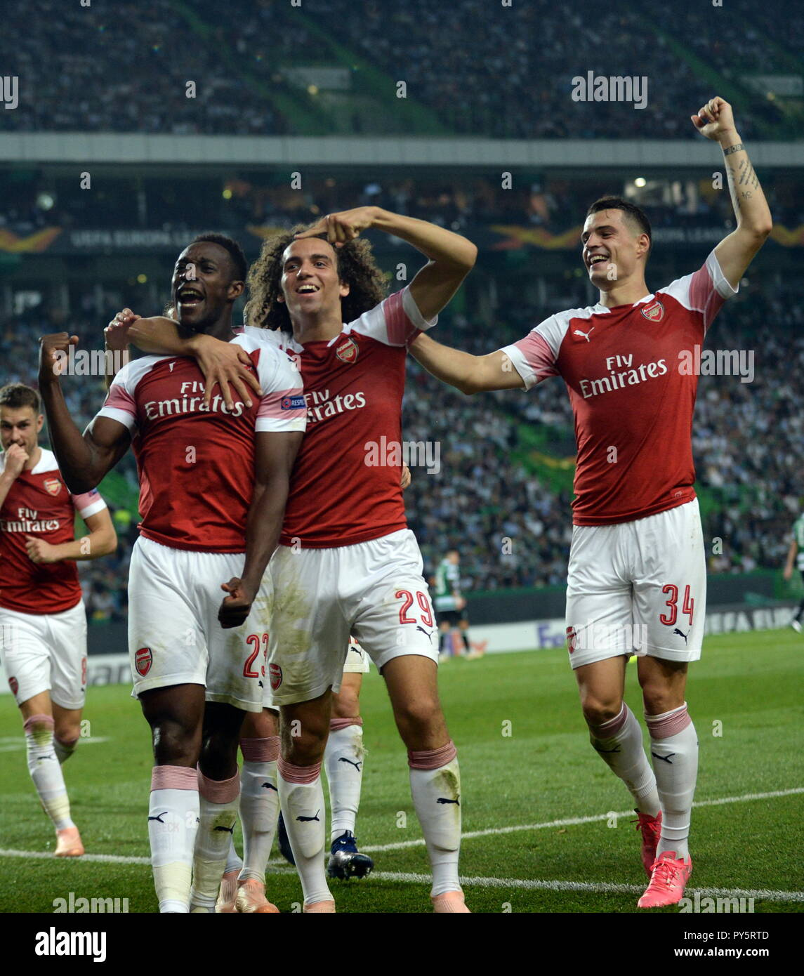 Lisbon, Portugal. 25th Oct, 2018. Players of Arsenal celebrate during the Europa League Group E third round soccer match between Sporting CP and Arsenal FC at Jose Alvalade Stadium in Lisbon, Portugal, on Oct. 25, 2018. Arsenal won 1-0. Credit: Zhang Liyun/Xinhua/Alamy Live News Stock Photo