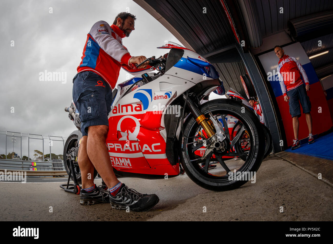 Melbourne, Australia. Friday, 26 October, 2018. Phillip Island, Australia. Danilo Petrucci's MotoGP bike is warmed up prior to the start of Friday Free Practice. Credit: Russell Hunter/Alamy Live News - Stock Image
