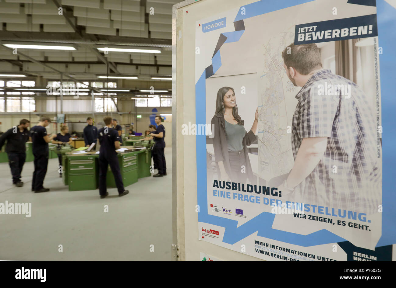 Berlin, Germany. 26th Oct, 2018. At the beginning of a press conference on the campaign 'Training: A question of attitude' at the training facility of Berliner Wasserwerke, trainees are standing at their workplaces. The campaign aims to recruit more trainees with a migration history. Credit: Wolfgang Kumm/dpa/Alamy Live News - Stock Image
