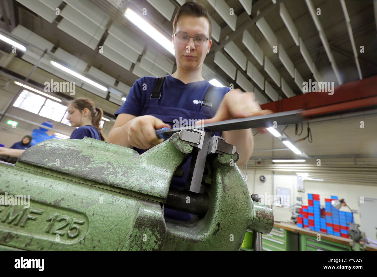 Berlin, Germany. 26th Oct, 2018. At the beginning of a press conference on the campaign 'Training: A Question of Attitude', a trainee in his first year of training is working on a workpiece at the training facility of Berliner Wasserwerke. The campaign aims to recruit more trainees with a migration history. Credit: Wolfgang Kumm/dpa/Alamy Live News - Stock Image