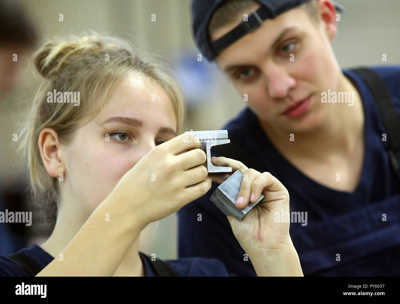 Berlin, Germany. 26th Oct, 2018. At the beginning of a press conference on the campaign 'Training: A Question of Adjustment' at the Berliner Wasserwerke training facility, trainees check the dimensional accuracy of a workpiece. The campaign aims to recruit more trainees with a migration history. Credit: Wolfgang Kumm/dpa/Alamy Live News - Stock Image