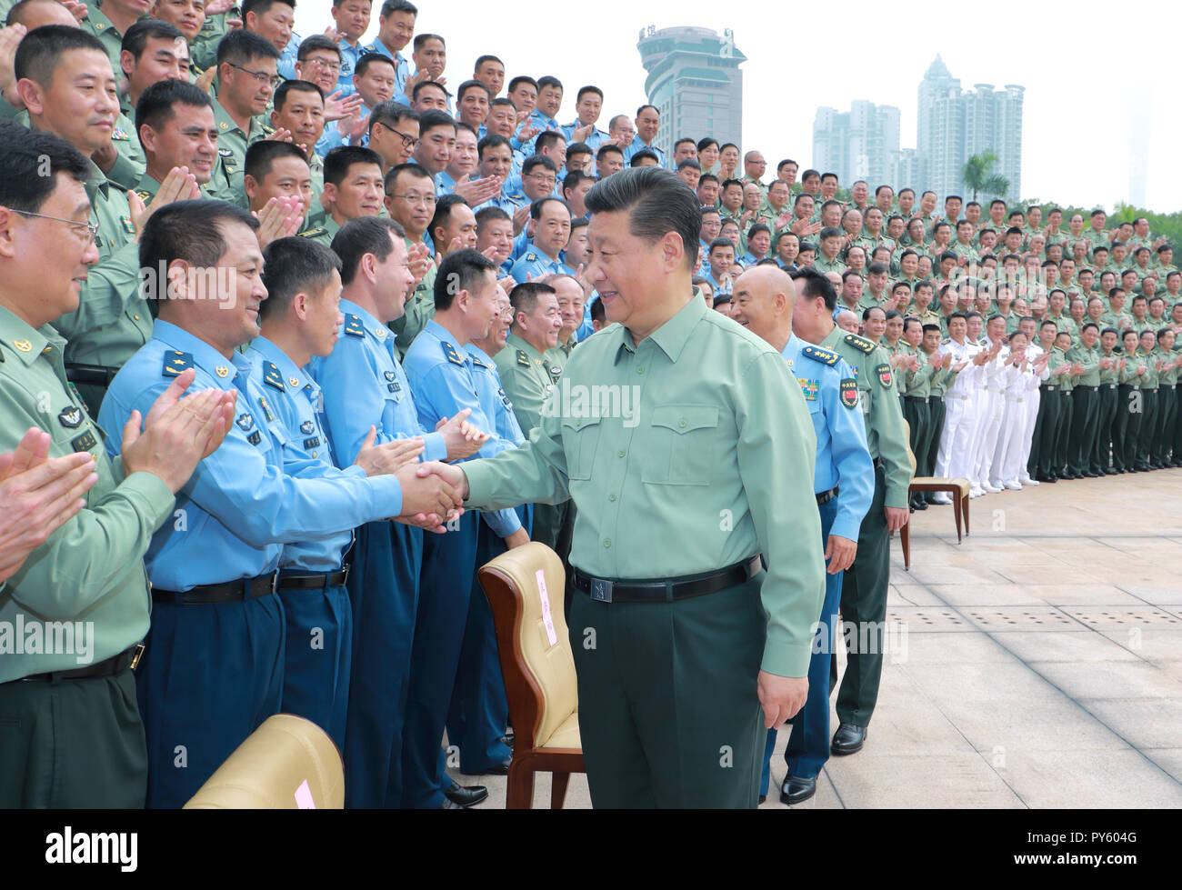 (181026) -- GUANGZHOU, Oct. 26, 2018 (Xinhua) -- Chinese President Xi Jinping, also general secretary of the Communist Party of China Central Committee and chairman of the Central Military Commission, shakes hands with military officers as he inspects the Southern Theater Command of the People's Liberation Army, Oct. 25, 2018.   (Xinhua/Li Gang) (wyo) - Stock Image