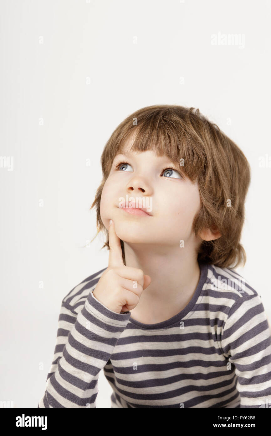 4 Year Boy Bedroom Decorating Ideas: Smart Little Boy's Portrait With Serious Thinking Face The