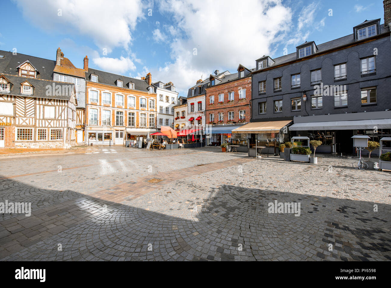 Beautiful facades of the old buildings in the central square in Honfleur, famous french town in Normandy - Stock Image