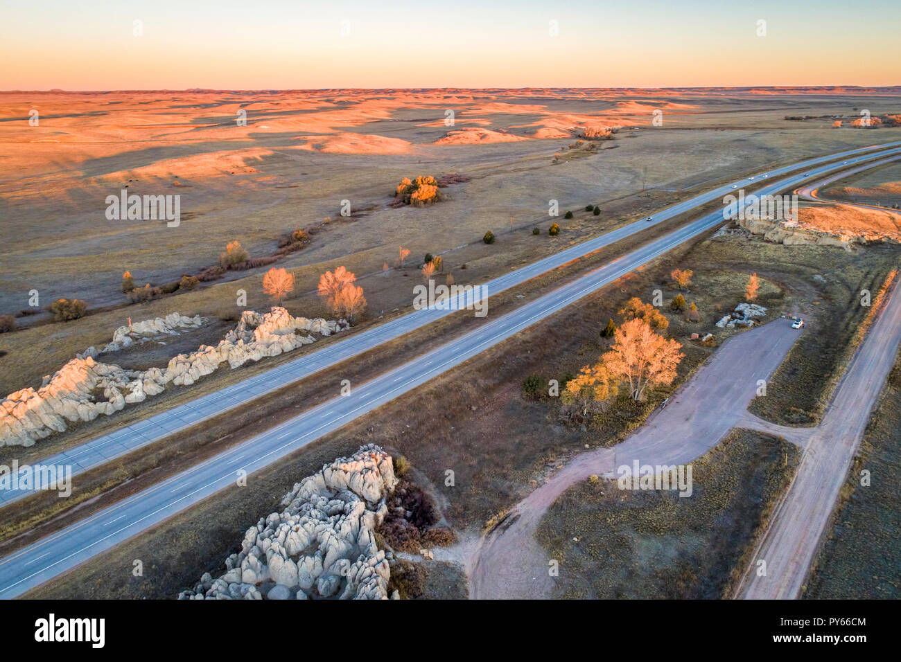 freeway (I-25) across rolling prairie in northern Colorado at