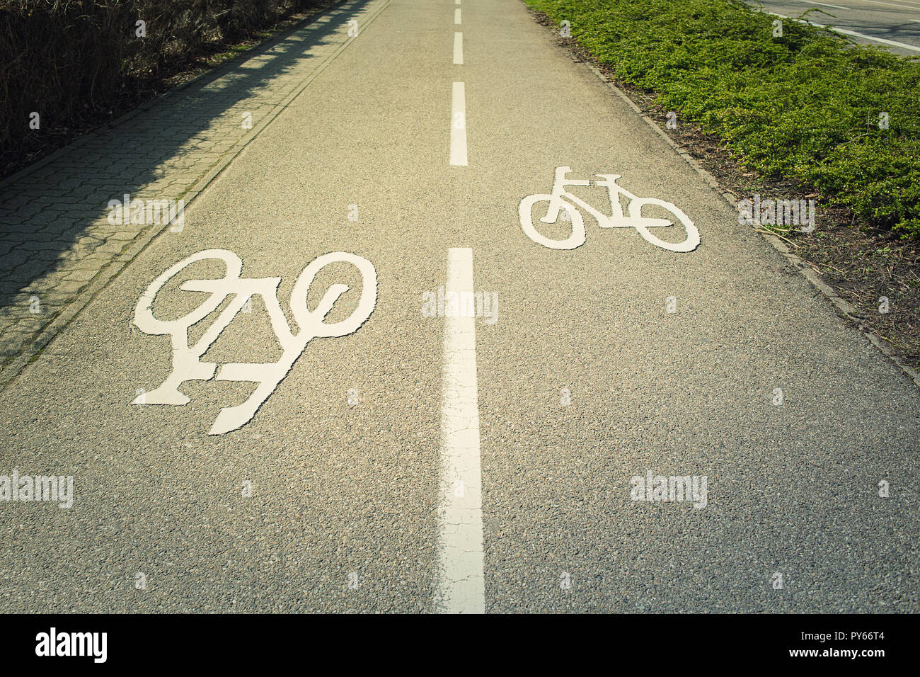 Bike lane asphalt road with marking destined for bicycle transportation. Stock Photo