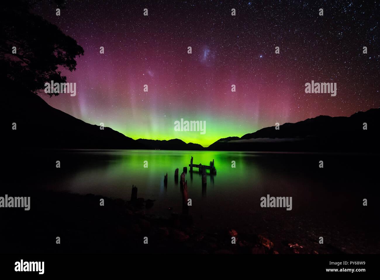 Broken jetty aurora at Meikel Johns bay near Glenorchy, New Zealand - Stock Image