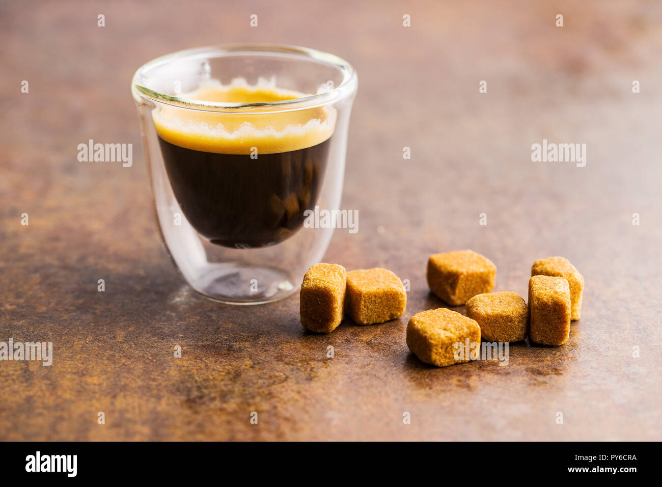 Cup of espresso coffee old kitchen table. - Stock Image