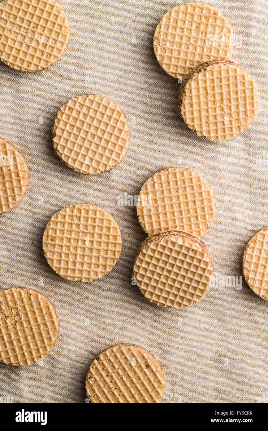 Sweet chocolate wafer biscuits on tablecloth. - Stock Image