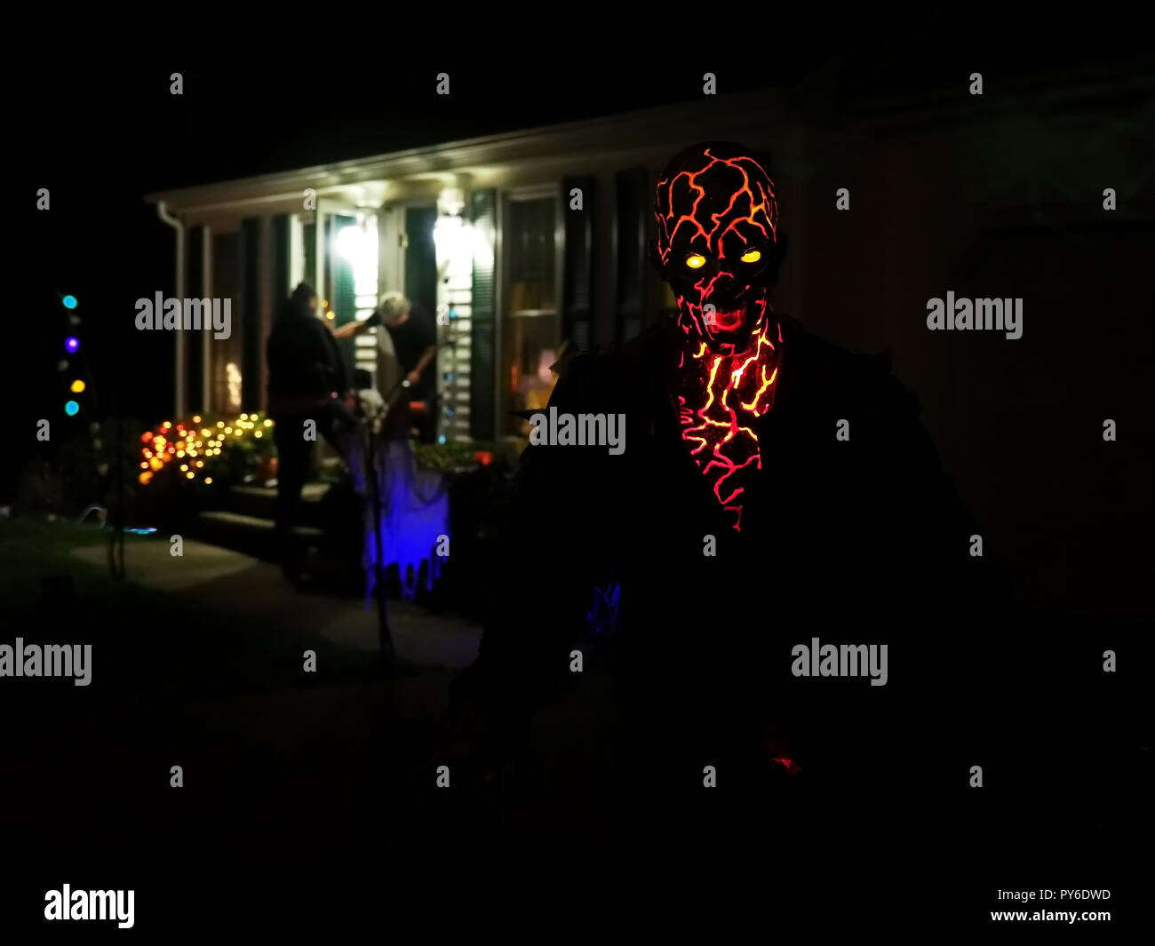 Truly frightening and scary is this Volcano or Lava monster man display at a New England Halloween. - Stock Image