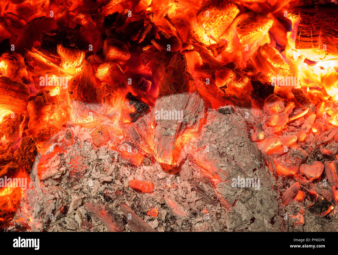Infinite details of screaming hot wood ember and ash - Stock Image