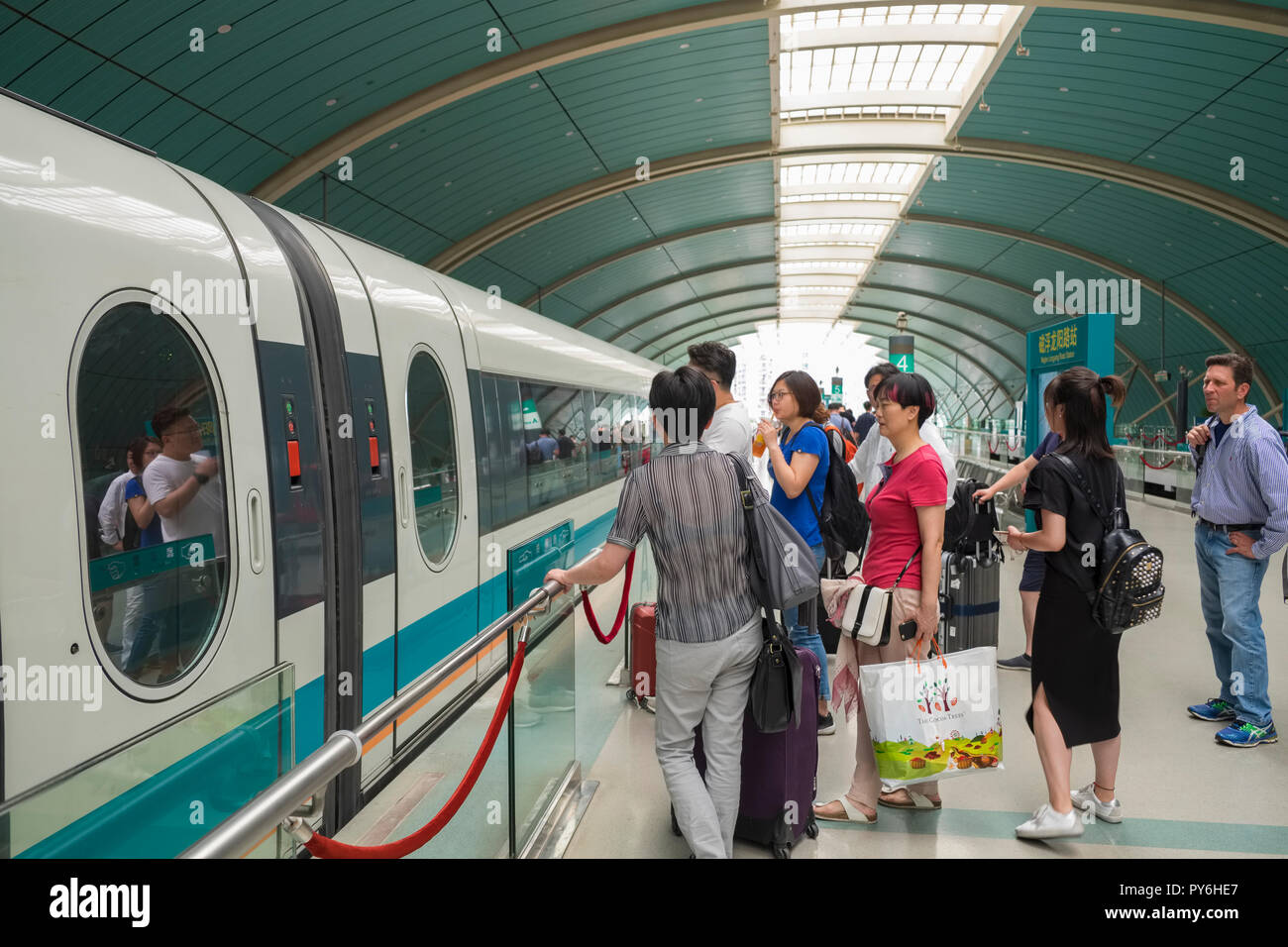 Passengers boarding a Maglev train in Shanghai, China, Asia - Stock Image