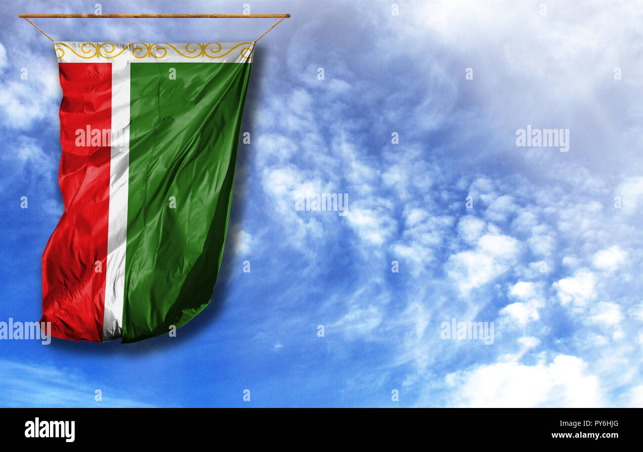 Flag of Chechen Republic. Vertical flag, against blue sky with place for your text - Stock Image