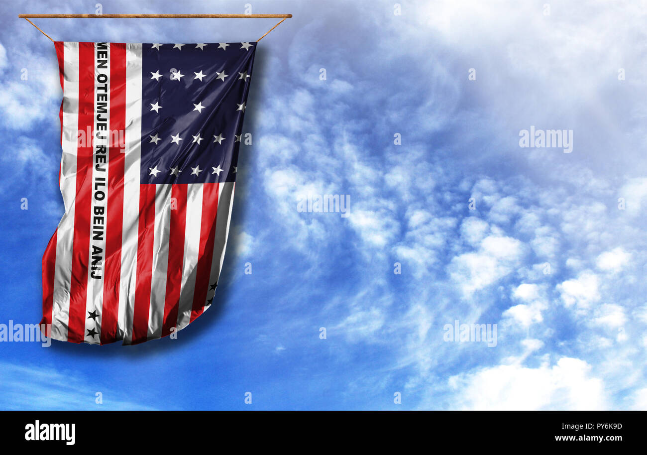 Flag of Bikini Atoll. Vertical flag, against blue sky with place for your text - Stock Image