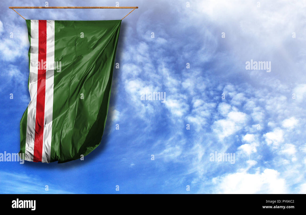 Flag of Chechen Republic of Ichkeria. Vertical flag, against blue sky with place for your text - Stock Image